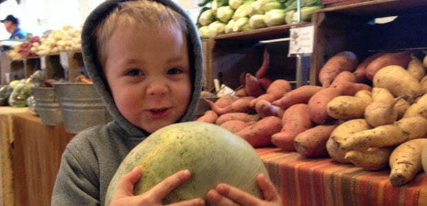 a child at a winter farmers market