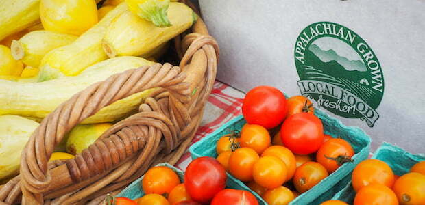 local food box with squash and tomatoes
